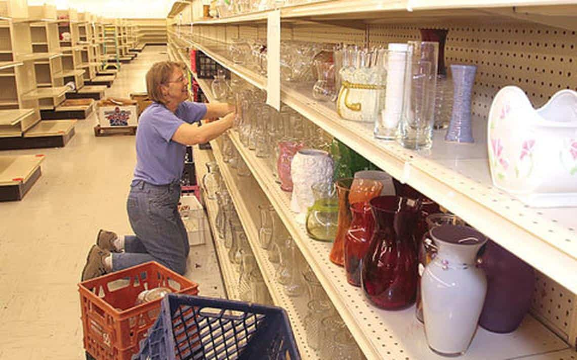 Staff stocking shelves