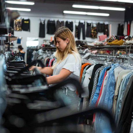 Girl thrift shopping
